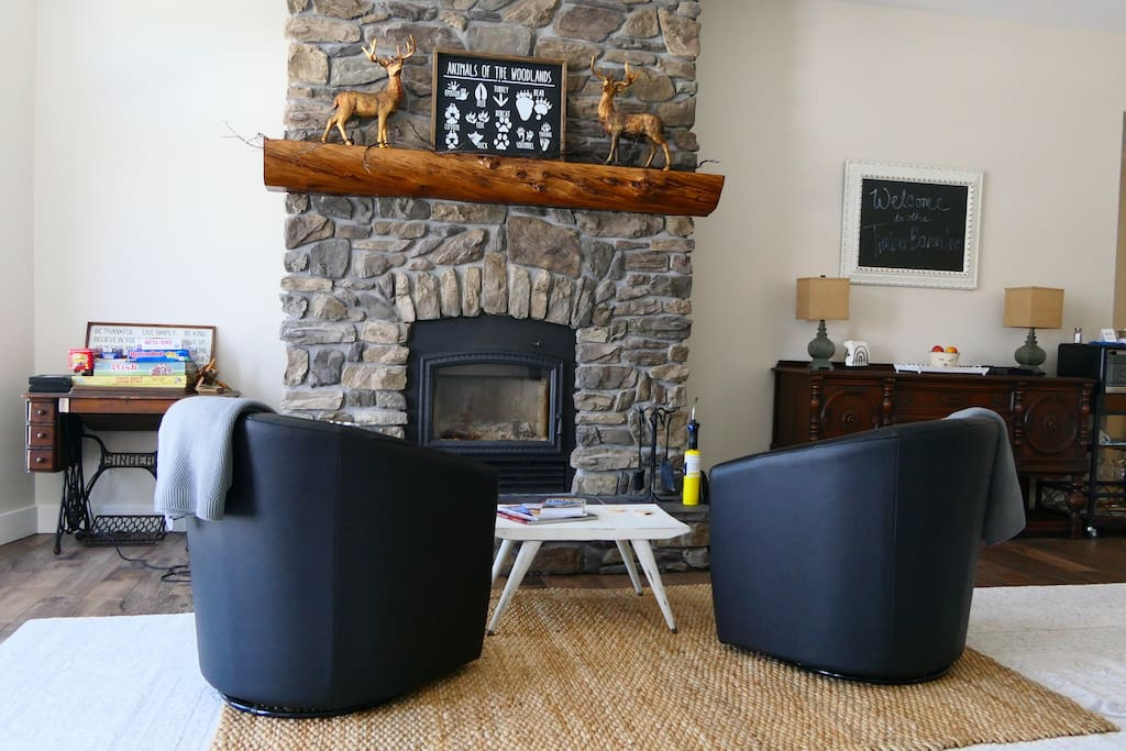 The fireplace which is operational in the fall and winter. To the left is our board game table perfect for slow evenings, rainy days, and snow days!