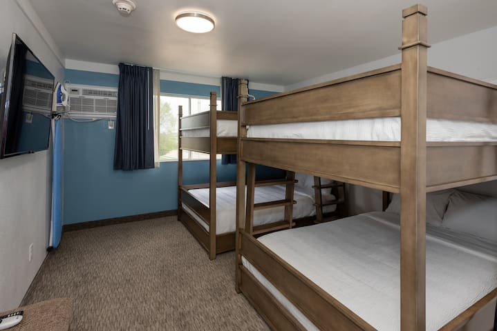 2 Full XL Bunks featuring Lucid memory foam mattresses. Comfortably sleep 4 adults or double up to sleep up to 8!