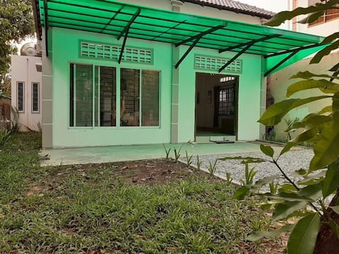 A House with Natural Light and Green Environment