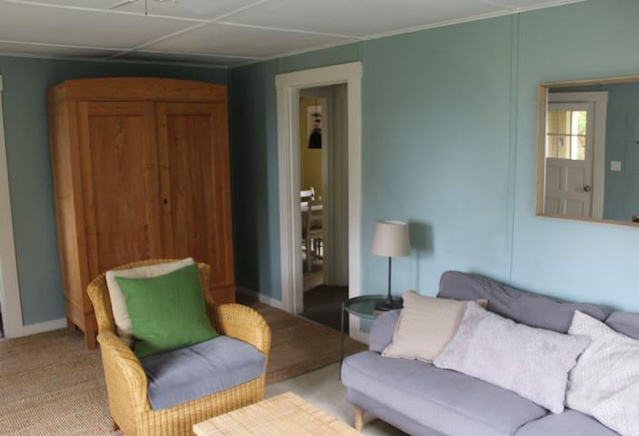livingroom with peek of the diningroom/hallway to bedroom and full bathroom