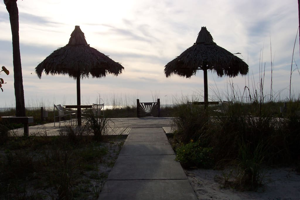 Enjoy a drink under the tiki huts at sunset