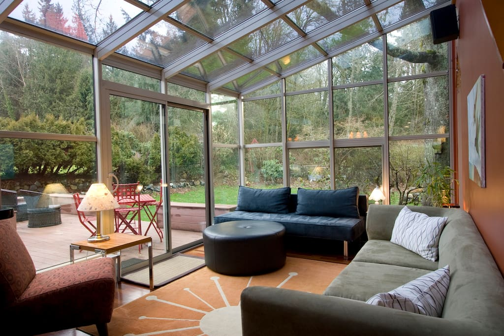 Glorious sunroom, bright and comfortable in all seasons.