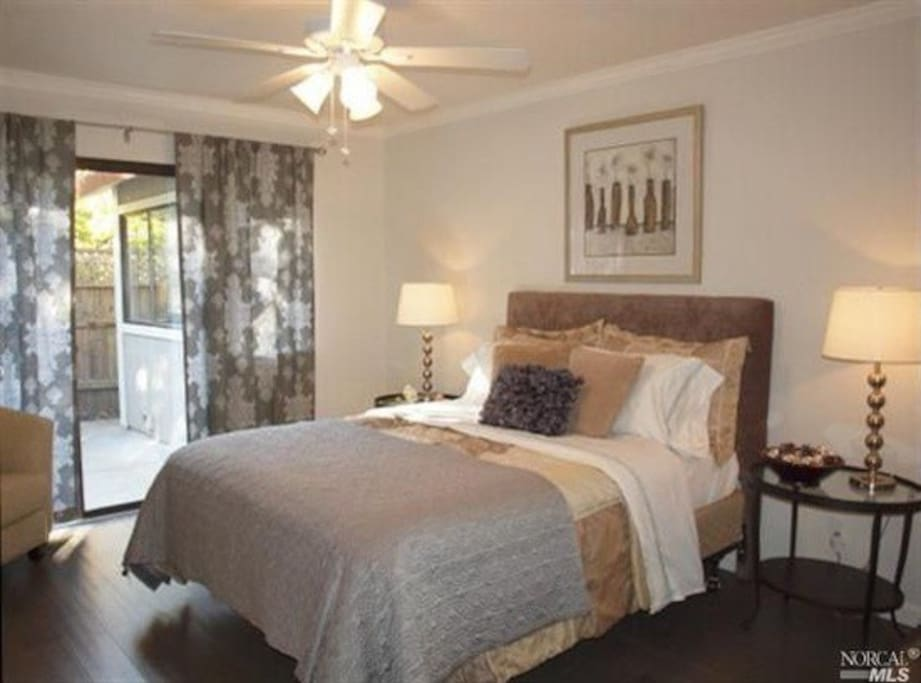 Clean and comfortable bedroom has access to backyard