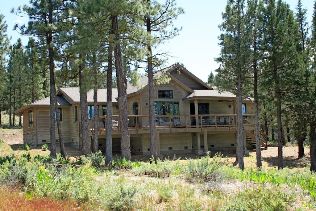 This is a view of the back of the house from the Dragon golf course's 14th fairway, detailing our full deck along the length of the back of the house for you to enjoy the sound of the wind through the pines as you lounge, or your grilling expertise while dining with friends or family.