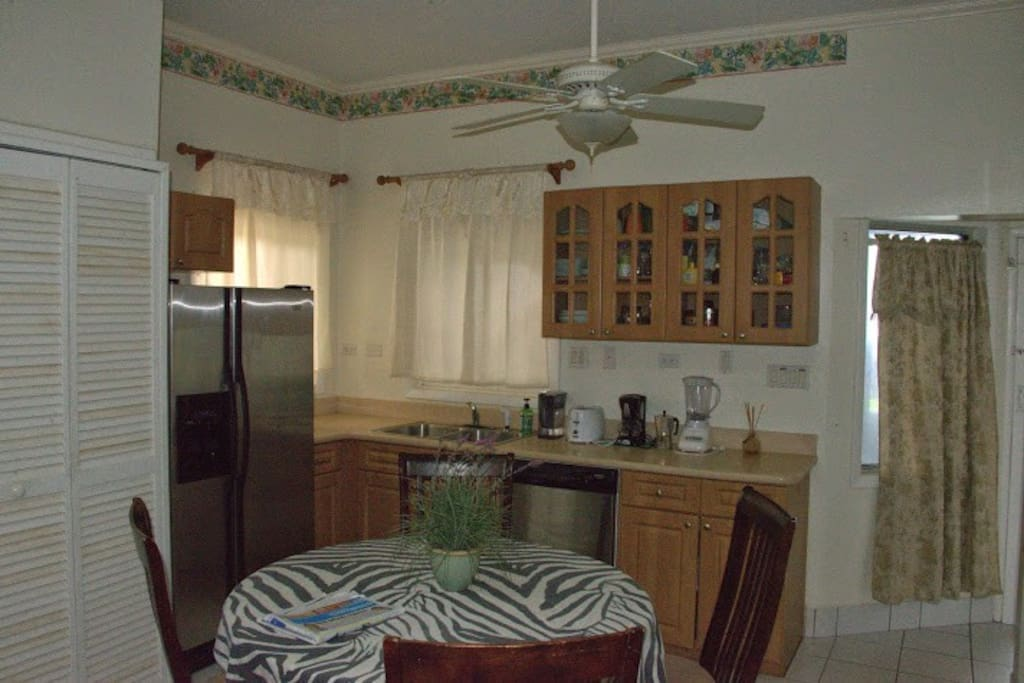 Fully equipped kitchen with coffee maker, oven, microwave, washer, dryer, fridge, freezer, icemaker, dishwasher