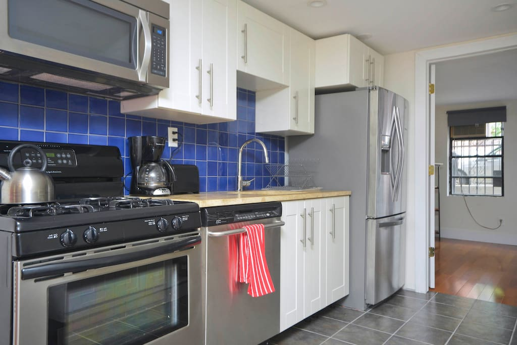 Newly renovated kitchen with gas stove, dishwasher,  french door refrigerator, toaster, coffee maker