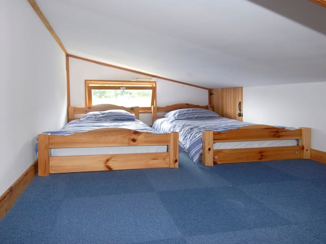 Low-ceilinged roof space with two beds for children, although often favoured by adults!