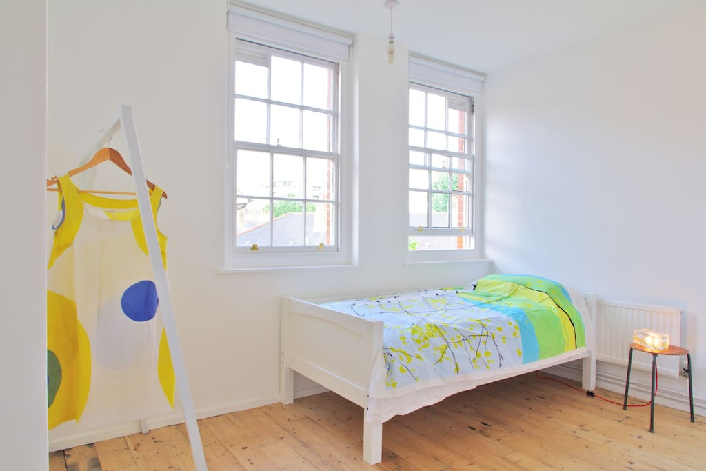 Single large bedroom 1. View of Shard.  All mattresses are ortho 1400 or 1600 and linen is mainly Egyptian Cotton. There are more items in the room than in this picture, eg more clothes on the hanging rail and items under the bed.