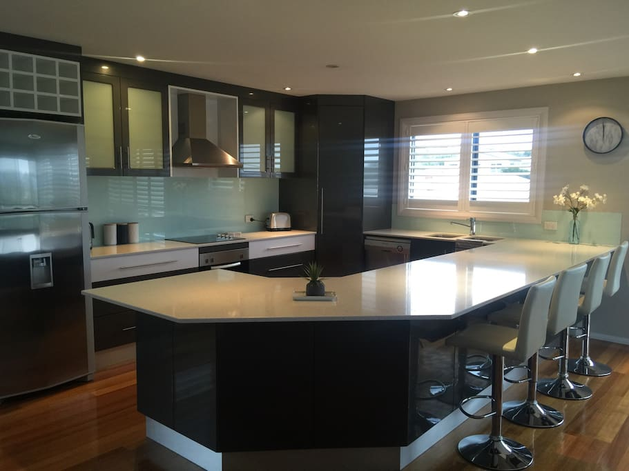 Large well appointed kitchen with breakfast bar, dishwasher and microwave