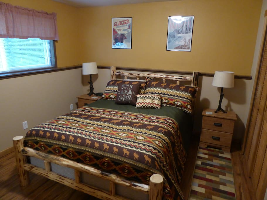 Queen bed with Montana made log frame