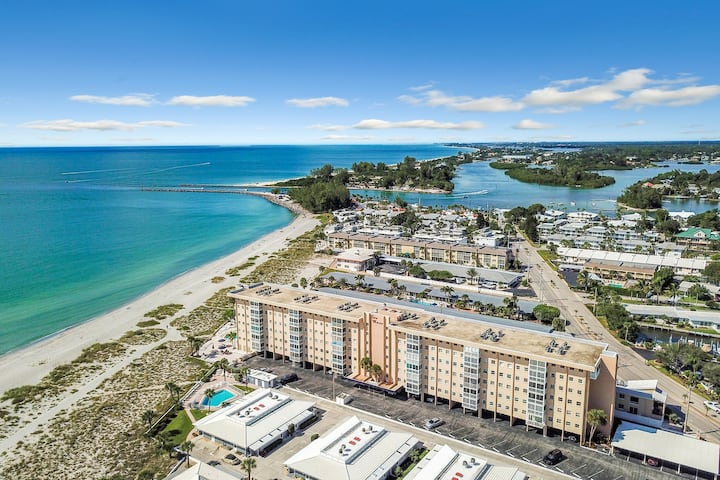 Bright and beachy Gulf front condo with shared heated pool in a perfect location