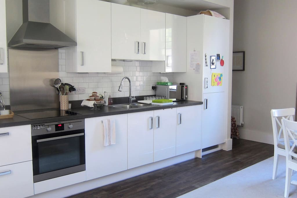 Fully equipped kitchen with dishwasher, oven, microwave, kettle, Nespresso machine and milk frother