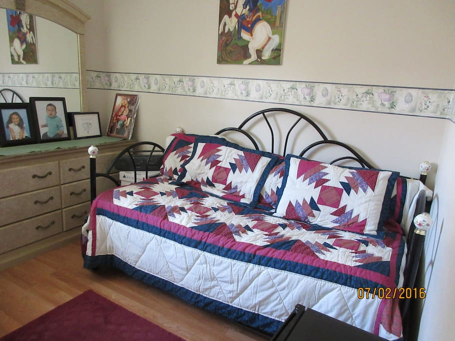 Room #1:  Bright  room--has desk, twin mattress daybed, dresser, & small frig.