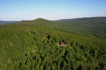 Adjoins National Forest