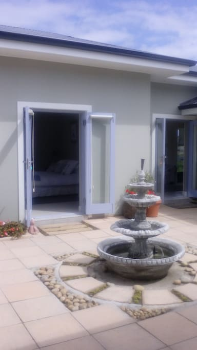 French doors opens into courtyard