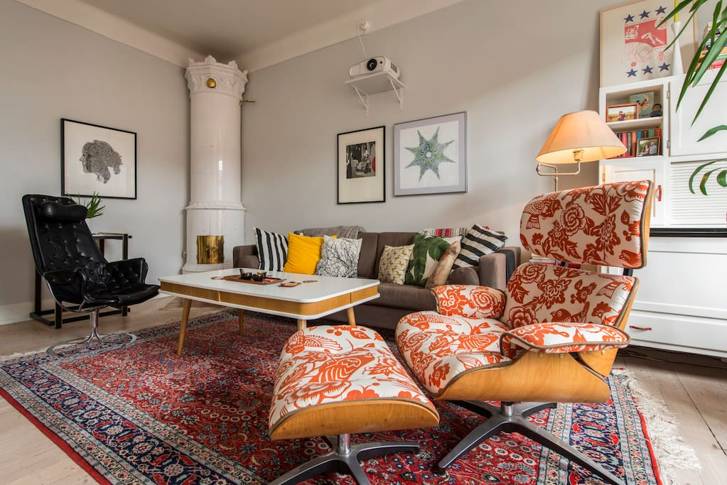 Large and bright living room with a traditional Swedish tile stove (kakelugn) in one corner
