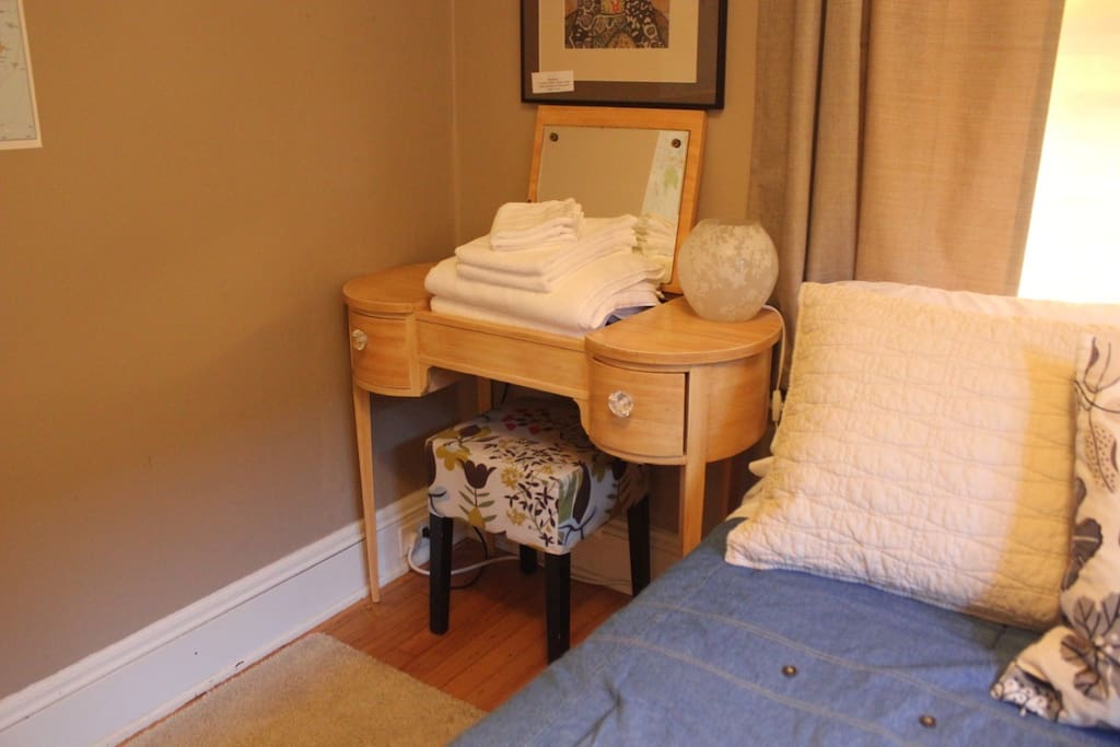 White wash, hand, and bath towels are provided for both guests.