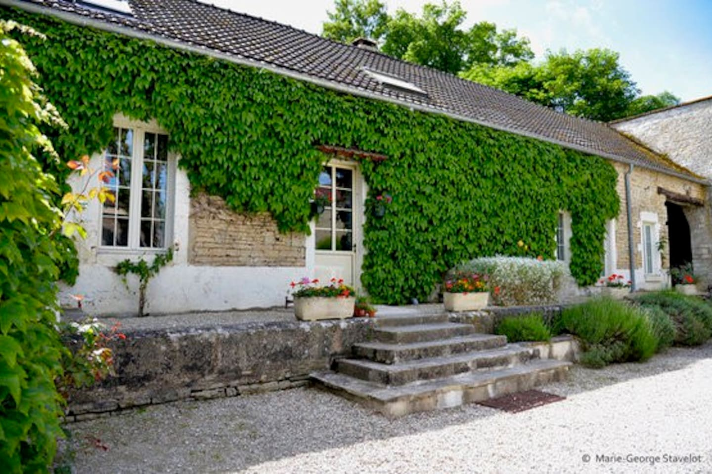 Coach House from the enclosed courtyard of Le Petit Village