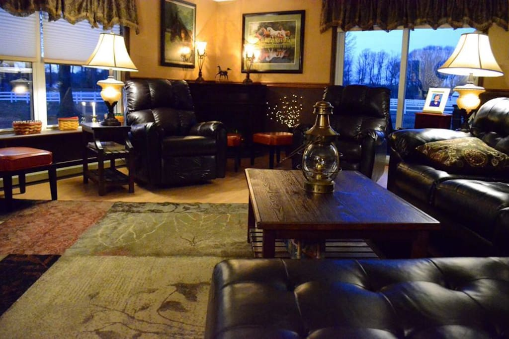 Spacious sun room area with cable television and a view of the farm pastures.