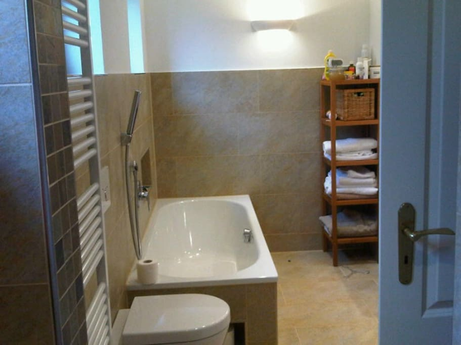 Bathroom with shower, toilet, bath and 2 washbasins. There is a second seperate toilet with small wash basin.