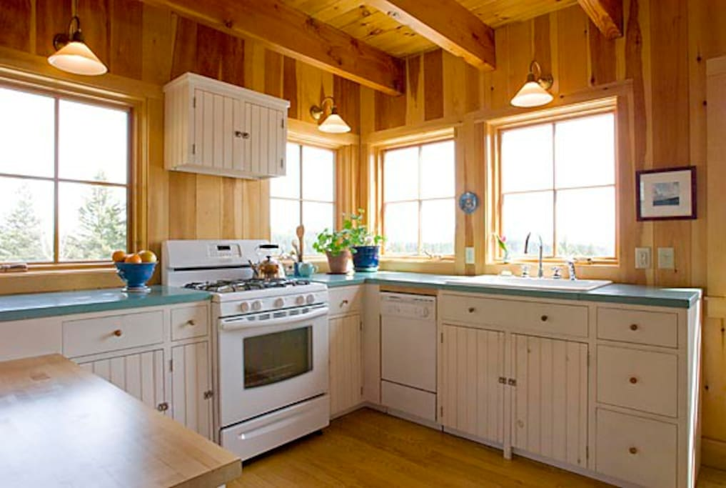Fully stocked kitchen with beautiful sunlight streaming in.