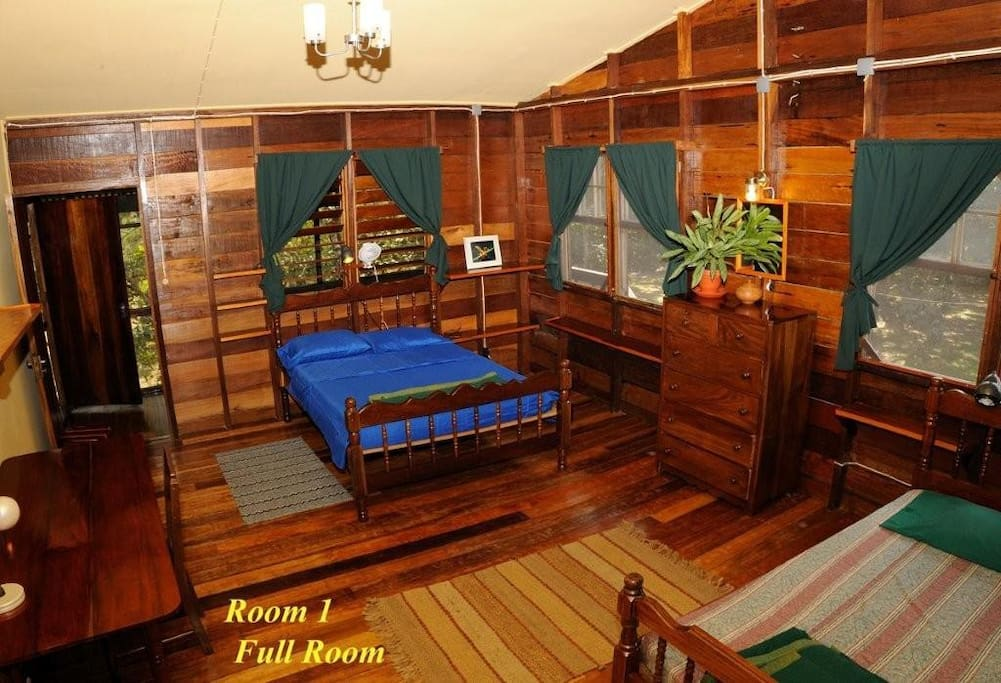 Comfortable room with  two double beds and private bathroom.