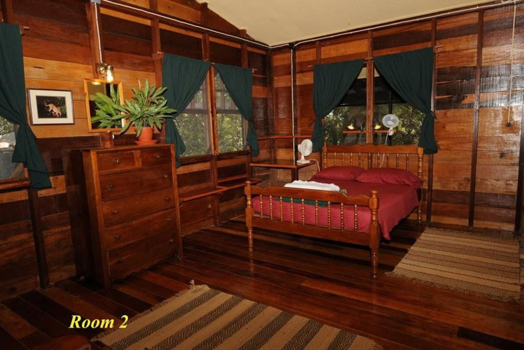 A room with a double bed and two singles with a private bathroom.