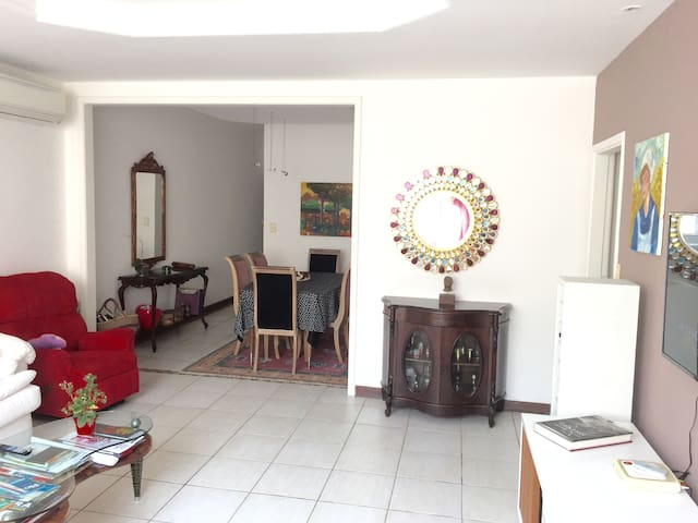 Living room with cable tv, DVD player, home theater, ceiling fan and air conditioning