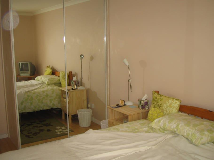 large wardrobe with mirror doors