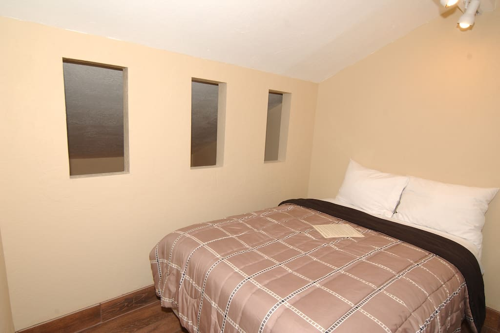 Private bedroom with double bed and attached private bathroom.