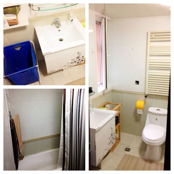 Private bathroom with bathtub and shower. Laundry hamper suitable for wanting to do laundry -- washer and Dryer available in apt!