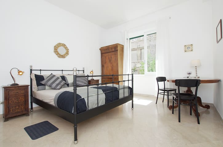 Large, bright room with double bed