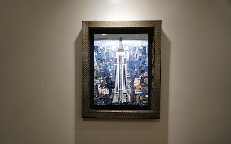 The iconic Empire State Building as seen in this detailed picture of NYC located in the apartment.;-)