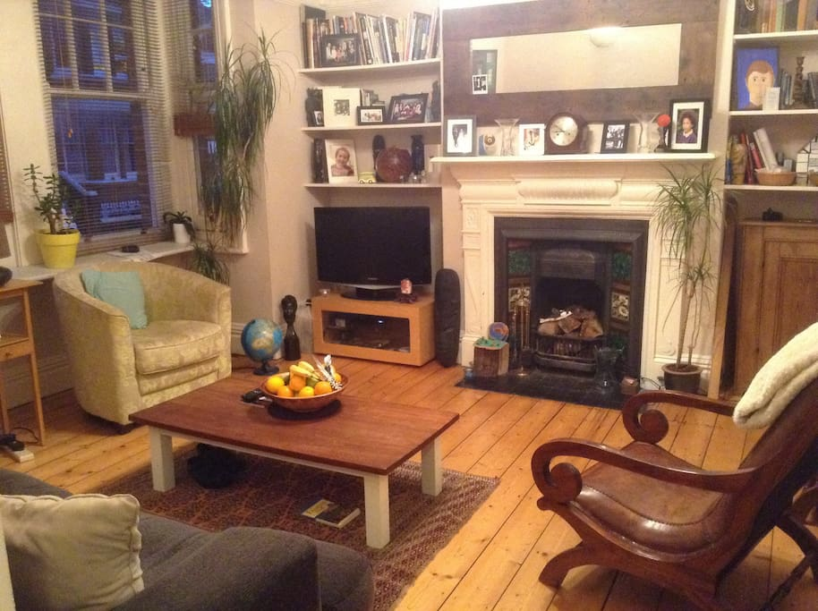 To the front of the house is a spacious living room, retaining charming original features. But you won't need the fireplace we hope! Stripped floorboards as throughout the property, but comfy and cosy at the same time. There's a large LCD TV and DVD playe