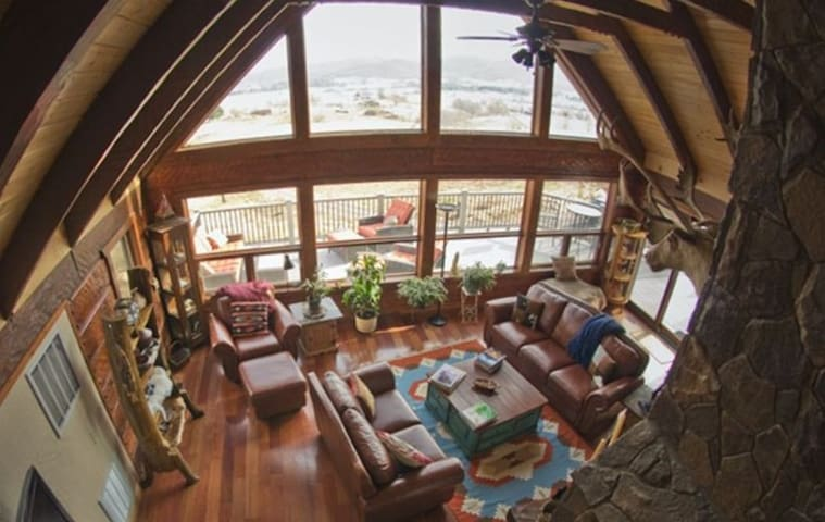 View from Loft to Great room with deck outside
