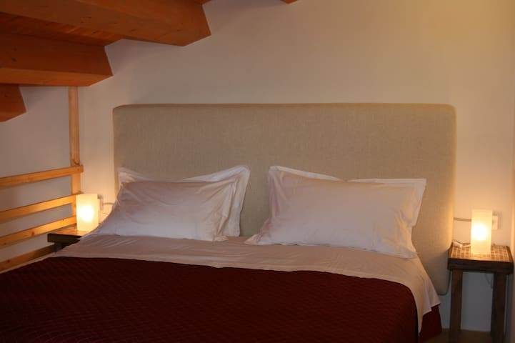 The double bed on the mezzanine