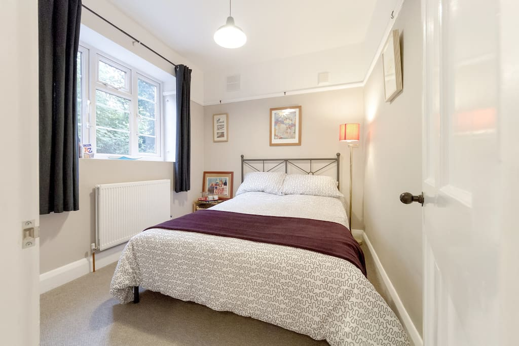 Your bedroom - with real double bed, hair dryer and storage for your luggage
