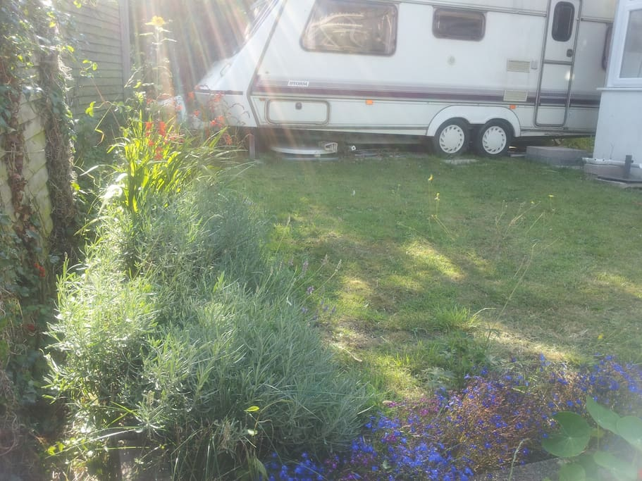 The caravan! A good size, stepping straight into our pretty garden