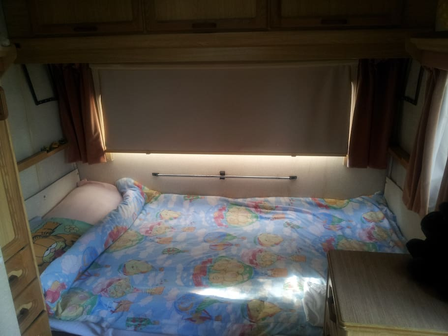 2nd sleeping space - at the other end of the caravan - a sliding door can be pulled most of the way across to give some privacy