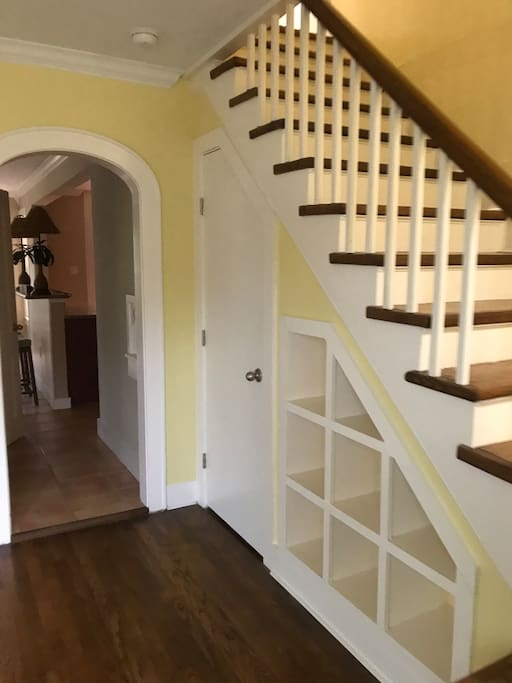 Stairs to bedrooms off dining area.