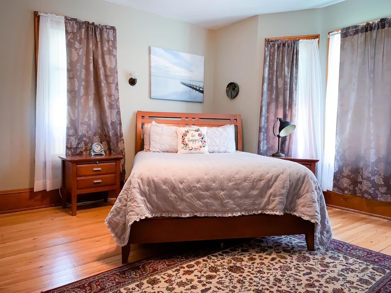 Quiet Artist's Retreat. Features queen size bed, fireplace, mini fridge, closet and en suite bathroom.