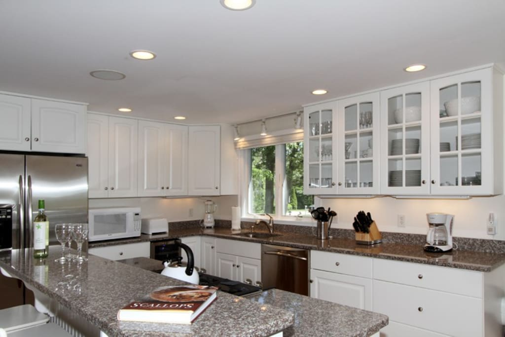 Updated kitchen featuring granite countertops, breakfast bar and stainless appliances.