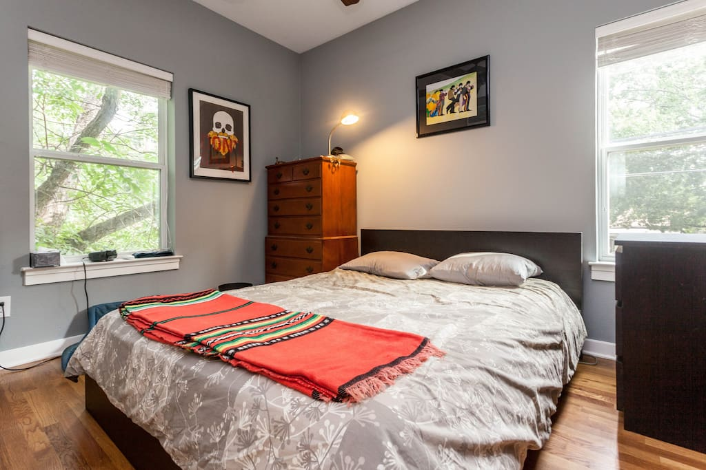 Bedroom with queen sized bed.
