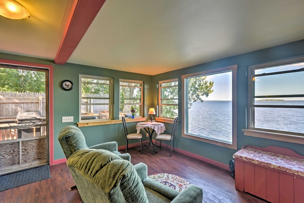 The open living area is filled with natural light, pouring from the windows throughout the cottage.