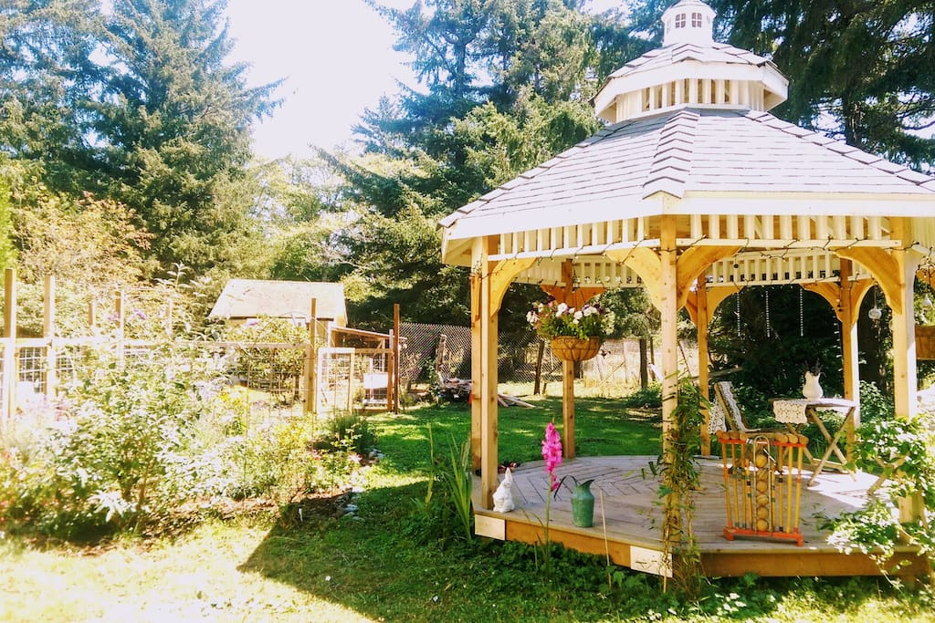 Relax in our garden underneath the shade of our gazebo.