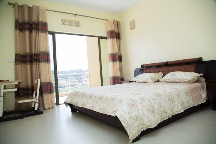 Master bedroom with access to the private balcony and a bed with a very soft mattress