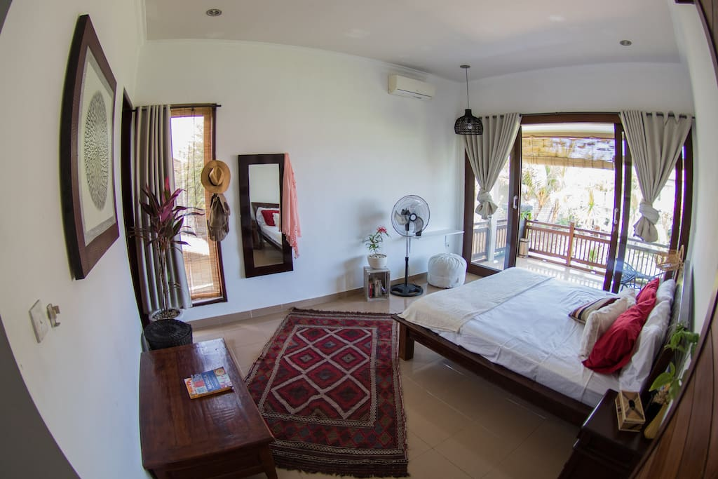 Upstairs Bedroom 2 with large balcony and rice field views.
