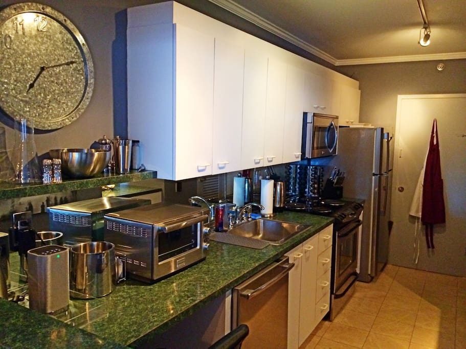 The kitchen is fully equipped with everything including blender, microwave, toaster oven, ice maker, food processor, coffee grinder, dishwasher and more. Everything was replaced in 2014