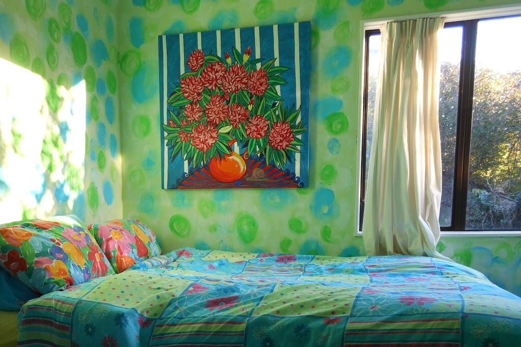sunny funky room with a comfy queen size bed with afternoon sun