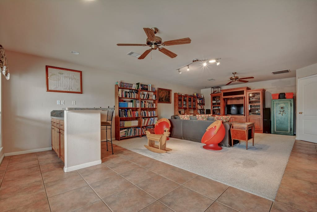 Let the kids have their own space in the lower level, with plenty of toys and a large flat-screen TV
